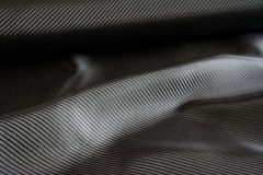 Carbon fiber composite raw material background. Black carbon fiber composite raw material background Stock Photo
