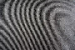 Carbon fiber composite raw material background Stock Image