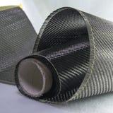 Carbon fiber composite raw material background Stock Photos