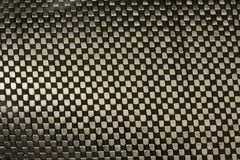 Carbon fiber fabric with epoxy resin background Stock Photography