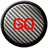 Carbon Fiber GO Button. A carbon fiber button with the word GO glowing in red Royalty Free Stock Image