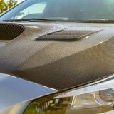 Carbon fiber hood and tallight of a silver car stock photo