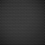 Carbon fiber industrial background with repeatable geometry. Dar. K, black dotted pattern. Punched, perforated surface. Abstract texture. - Royalty free vector Royalty Free Stock Photography