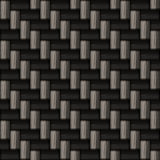 Carbon fiber pattern. A diagonally woven carbon fiber background texture - a great art element for that high-tech look you are going for.  This tiles seamlessly Royalty Free Stock Image