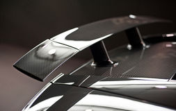 Carbon fiber spolier. On  a sports car that will improve downforce Royalty Free Stock Image