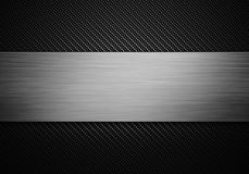 Carbon fiber texture with polish metal plate on center Stock Image