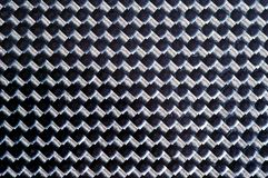 Carbon fibre. Close up of a carbon fibre material Stock Photos