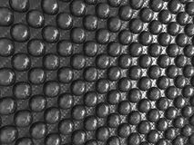 Carbon fibre with Abstract pimples. Useful as background Royalty Free Stock Images