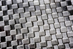 Carbon fibre background. Close up of a carbon fibre material Stock Photo