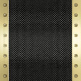 Carbon fibre gold metal background. Image of carbon fibre inlaid in gold metal frame Royalty Free Stock Photo
