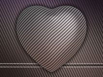 Carbon fibre heart on stetiched background. Carbon fibre heart shape over stetiched background. Large resolution Stock Image