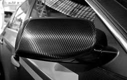 Carbon fibre mirror Stock Photos
