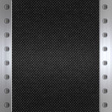 Carbon fibre and steel background. Image of carbon fibre inlaid in brushed metal frame Royalty Free Stock Image
