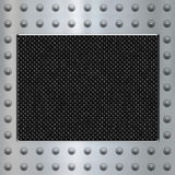 Carbon fibre and steel background. Image of carbon fibre inlaid in brushed metal frame Stock Images