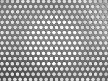 Carbon fibre surface with holes. Over studio light background Stock Image