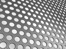 Carbon fibre surface perforated. Over studio light background Stock Image