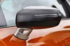 Carbon fibre wing mirror Stock Photo