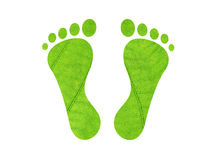 Carbon footprint. Green leaf textured footprints isolated on white Stock Photography