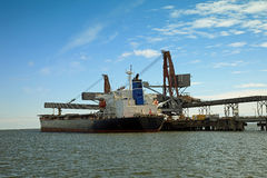 Carbon loading in ship Royalty Free Stock Photos