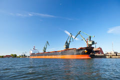 Carbon loading in ship. Stock Photo
