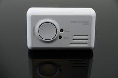 Carbon Monoxide Detector. Carbon monoxide alarm on black background royalty free stock images