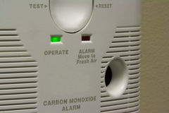 Carbon monoxide alarm. Close-up of a functioning carbon monoxide detector installed on a wall. A carbon monoxide detector is used indoors to prevent accidental Stock Photography