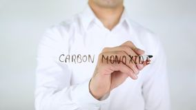 Carbon Monoxide, Man Writing on Glass, Handwritten. High quality royalty free stock images