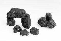Carbon nuggets. On a white background Stock Photos