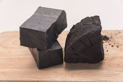 Carbon soap  and a pile of coal Royalty Free Stock Images