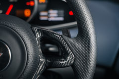 Carbon on steering wheel Stock Photos