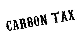 Carbon Tax rubber stamp. Grunge design with dust scratches. Effects can be easily removed for a clean, crisp look. Color is easily changed Stock Photography