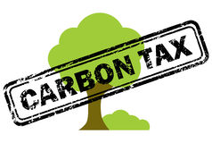 Carbon tax rubber stamp over tree icon Stock Image