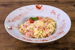 Carbonara pasta with cheese. And tomato Stock Photo