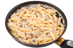 Carbonara pasta in a pan. Isolated on white background Royalty Free Stock Images