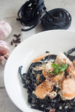 Carbonara squid ink with sausages Royalty Free Stock Images
