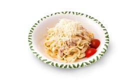 Carbonara-Teigwaren mit Tomaten Lizenzfreie Stockfotografie