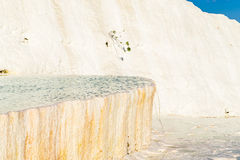 Carbonate travertines with blue water, Pamukkale Royalty Free Stock Image