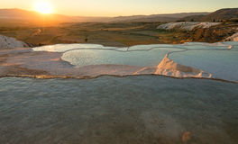 Carbonate travertines with blue water, Pamukkale Stock Photos