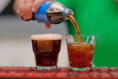 Carbonated drink poured into a glass Royalty Free Stock Image