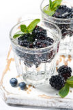 Carbonated drinks with fresh berries, vertical. Closeup Royalty Free Stock Image