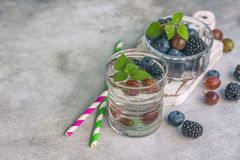 Carbonated drinks in glass with fresh berries. Selective focus Royalty Free Stock Image