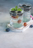 Carbonated drinks in glass with fresh berries. Selective focus Stock Images