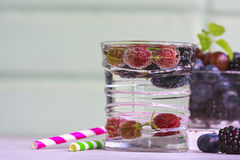 Carbonated drinks in glass with fresh berries. Selective focus Stock Photography