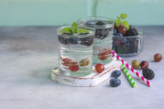 Carbonated drinks in glass with fresh berries. Stock Photo