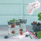 Carbonated drinks in glass with fresh berries. Royalty Free Stock Images