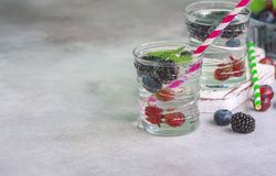 Carbonated drinks in glass with fresh berries. Royalty Free Stock Photos