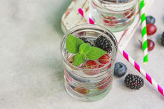 Carbonated drinks in glass with fresh berries. Stock Photos