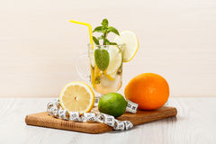 Carbonated lemonade with lemon slices and mint on an wooden cutt Stock Photo