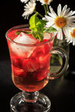 Carbonated lemonade with strawberry slices and mint with flowers Stock Photography
