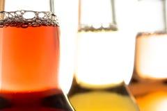 Carbonated lemonades in glass bottles Stock Image